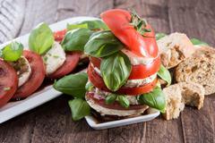 Stacked tomato and mozzarella slices Stock Photos