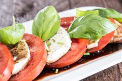 Plate with tomato and mozzarella Stock Photos