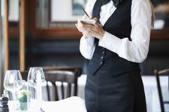 Young waitress taking order Stock Photos