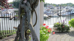 Boat Harbor from a flowery gazebo Stock Footage