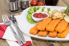 fish fingers with fried potatoes - stock photo