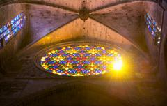 Sunshine through the stained-glass window of the cathedral in palma de mallor Stock Photos