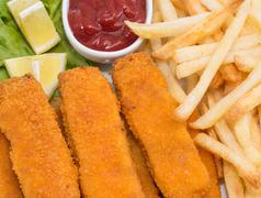 Fish fingers with chips (macro view) Stock Photos