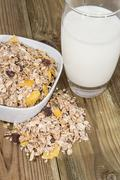 mixed muesli with a glass of milk - stock photo