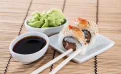 fresh sushi rolls on a small plate - stock photo