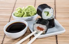 stacked maki rolls on a plate - stock photo