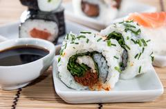 sushi rolls with sticks and soy sauce - stock photo
