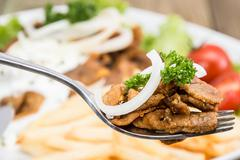 fresh kebab meat on a fork - stock photo