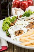 plate with chips and fresh kebab - stock photo