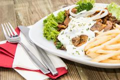 portion of kebab meat with chips - stock photo