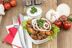 bowl filles with kebab meat on wood - stock photo