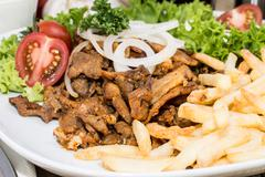fresh chips with kebab meat - stock photo