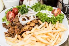 portion of kebab meat on a plate - stock photo