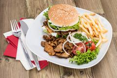 kebab burger with chips on wood - stock photo
