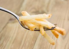 fork with french fries - stock photo