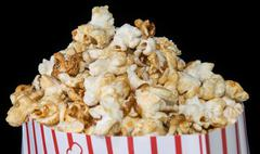 popcorn on black background - stock photo