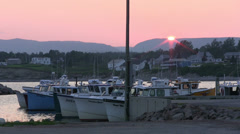 Sunset Over Fishing Village Stock Footage