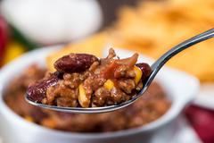 chili con carne on a spoon - stock photo