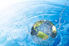 Earth falling into water  (elements of this image furnished by nasa) Stock Illustration