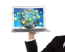 business person holding laptop with social network on earth (elements of this - stock illustration