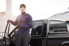 USA, Washington, Seattle, man in workout wear getting out of truck Stock Photos