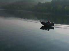 Fishing boat cruising at sunrise Stock Footage