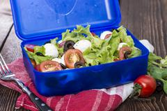 healthy lunchbox with fresh salad - stock photo
