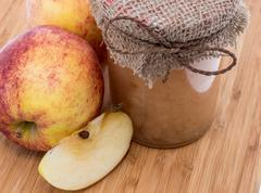 Stock Photo of fresh made applesauce on wooden background