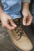 Tying up boot laces Stock Photos