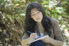 Young female sketching Stock Photos