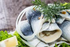 herring filets on a plate - stock photo