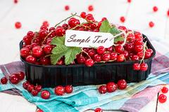 red currants with empty sign - stock photo
