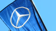Stock Video Footage of Mercades-Benz Logo flag flying in the sky Munich Germany