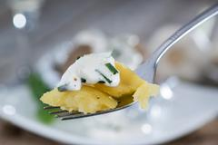 Stock Photo of baked potato on a fork