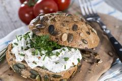 curd and herbs on a roll - stock photo