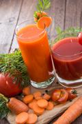 carrot- and tomato juice - stock photo