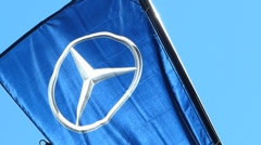 Mercades-Benz Logo flag flying in the sky Munich Germany Stock Footage