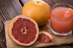 portion of grapefruit juice - stock photo