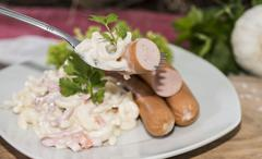 Portion of pasta salad with sausages Stock Photos