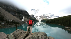 Male hiker Moraine Lake Valley Alberta, Canada Stock Footage