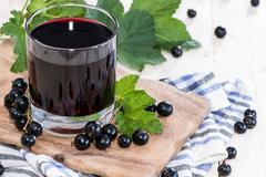 Stock Photo of fresh black currant juice