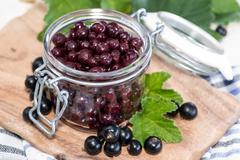 preserved black currants - stock photo