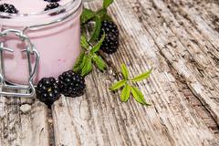 Glass with fresh blackberry yogurt Stock Photos
