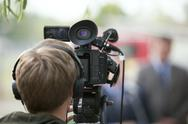 Stock Photo of covering an event with a video camera
