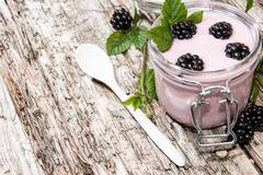 Glass with fresh blackberry yogurt Stock Photos