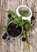 Blackberry jam in a glass Stock Photos
