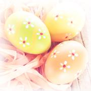 abstract easter background. macro shot of painted eggs and ribbon decoration  - stock photo