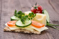 crispbread with cheese and herbs - stock photo