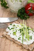 Fresh cream cheese on crispbread Stock Photos