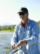 USA, Colorado, Aikuinen mies perhokalastus Kuvituskuvat